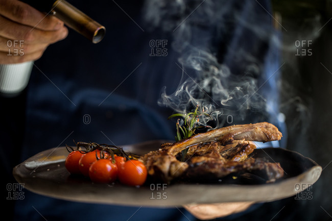 Smoke coming from gourmet dish after chef torched the food