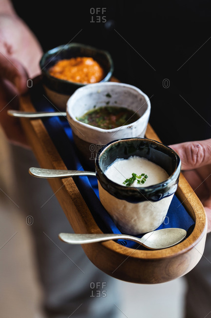 Person holding tray with a variety of sauces