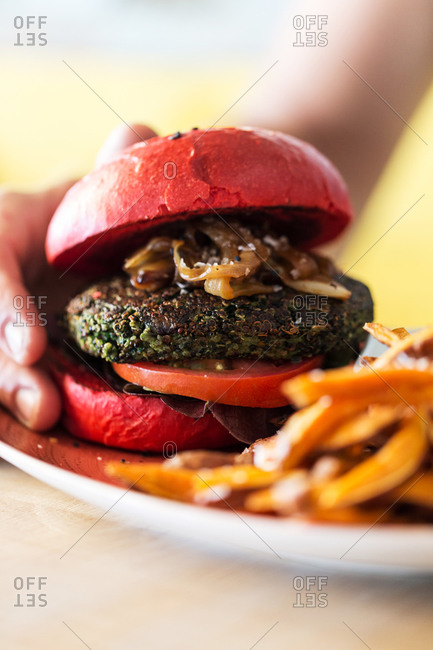 Veggie burger on a red bun