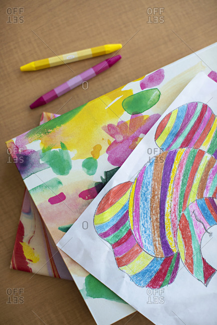 Overhead view of a child's colorful artwork
