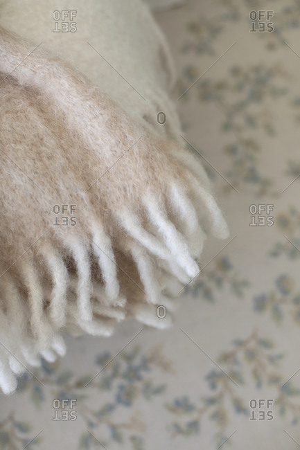 Close up of a white wool scarf