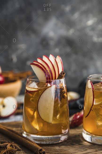 Apple spiced cider, served on ice, with apple garnish,