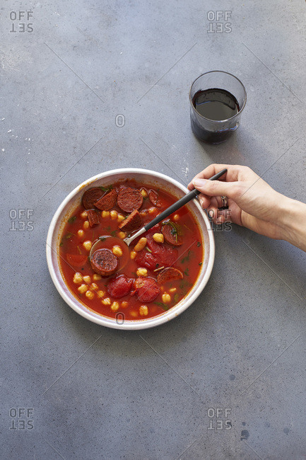 Tomato soup with chickpeas, chorizo sausage and parsley