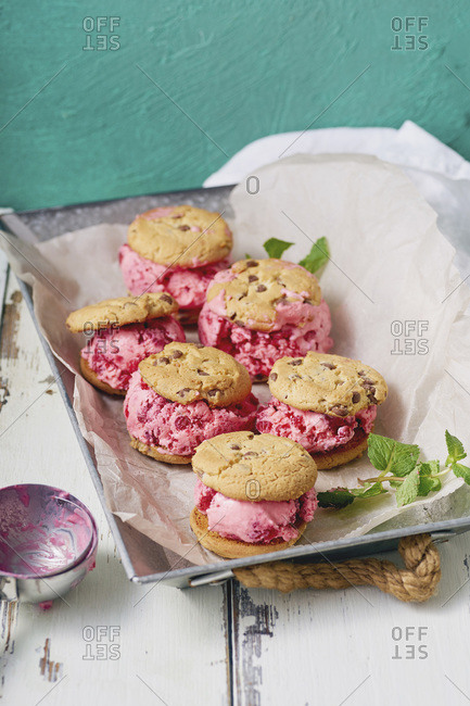 Raspberry ice cream sandwiches with chocolate chip cookies