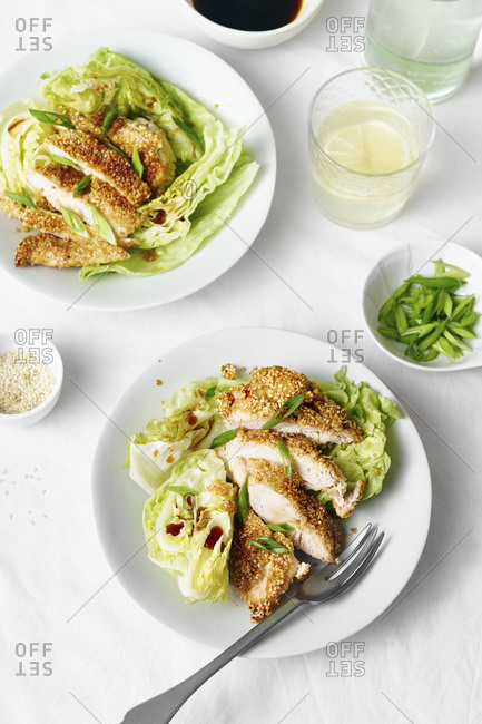 Sesame chicken salad with lettuce wedges and honey dressing