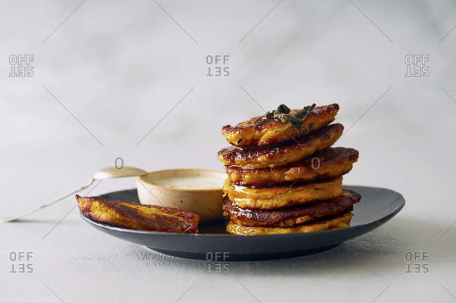 Pumpkin fritters with sage butter and yoghurt