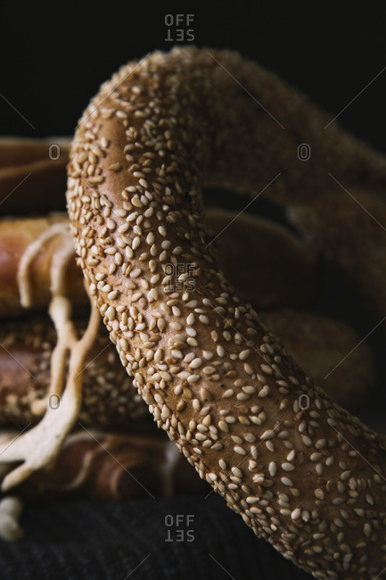 Macro Bread Pretzel and Bagel on a wooden table