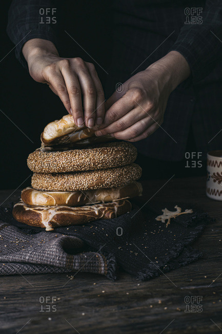 German Bread Pretzel and Bagel Breakfast on a wooden table. Black Background