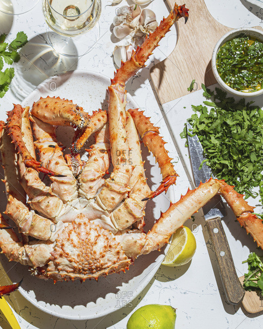 King Crab with herb lemon sauce and white wine.