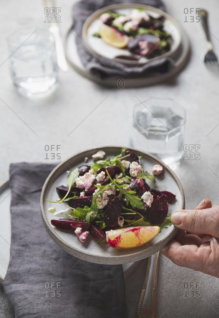 Beetroot salad with ricotta cheese, lemon and arugula.