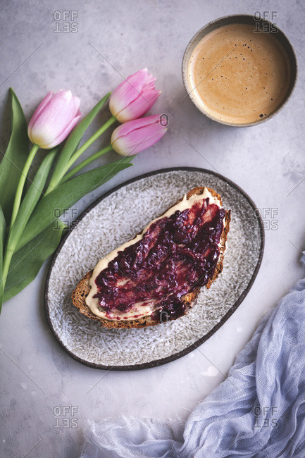 Slice of rye bread with tahini and jam