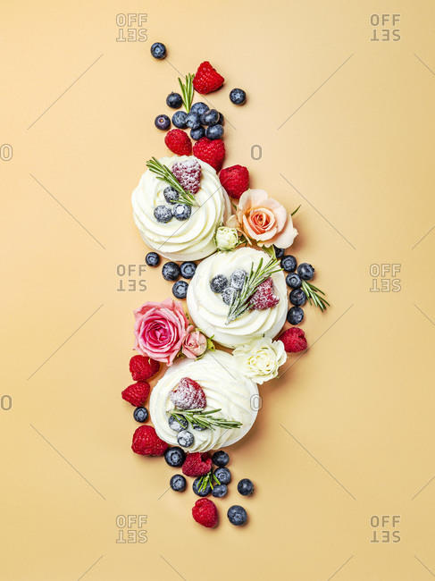 Beautiful creative layout of mini pavlova cakes in top view.