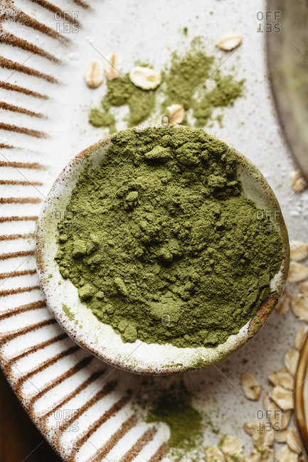 Loose matcha powder into a small bowl on a plate