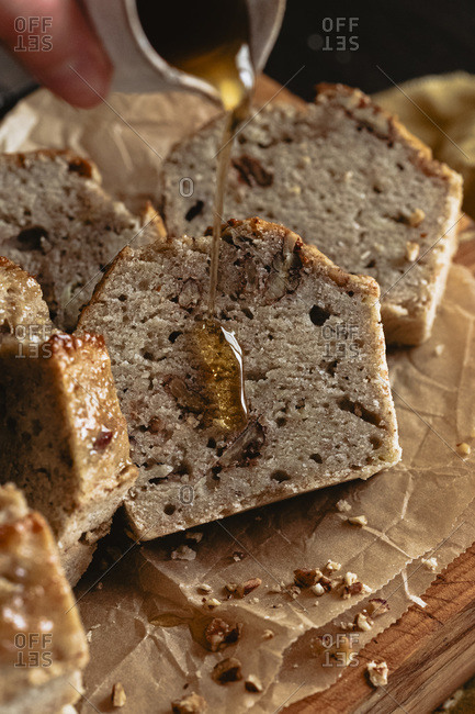 Drizzle of maple syrup on a slice of healthy banana bread