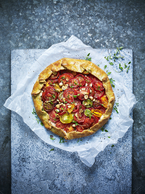 Mixed tomato tart against a blue background