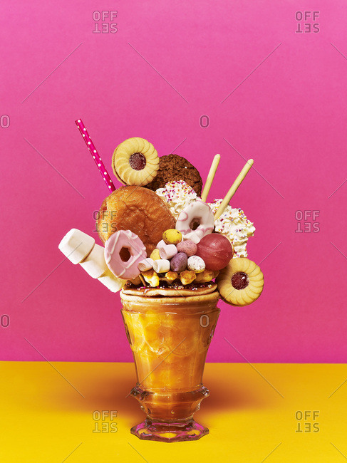 Doughnut freak shake with biscuits, doughnut, cream and marshmallows