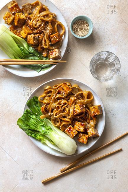 Teriyaki noodles with fried tofu and bok choy.