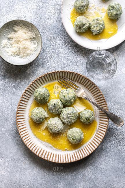 Spinach ricotta gnudi on a plate.