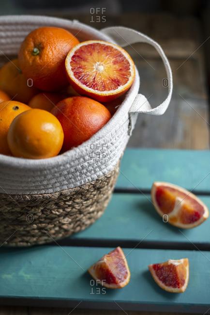 Blood oranges basket on a blue wood table
