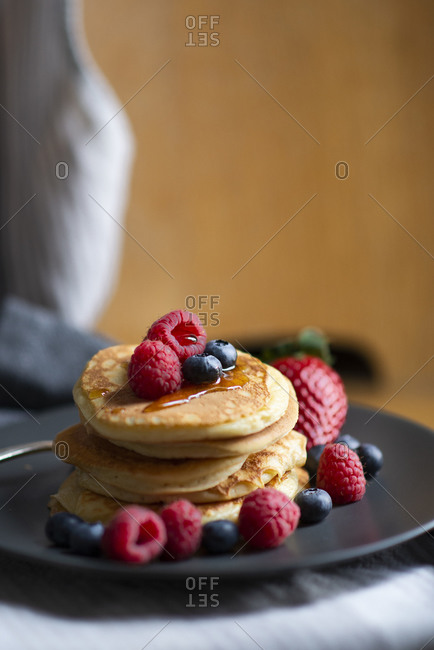 Ricotta cheese pancakes with fresh soft-fruit and maple syrup