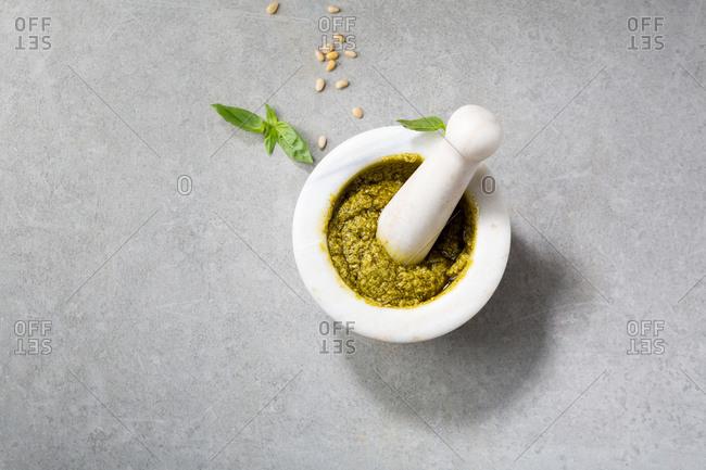 Green pesto in white mortar