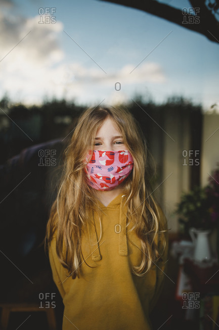 A blonde girl wearing hand made protactive mask