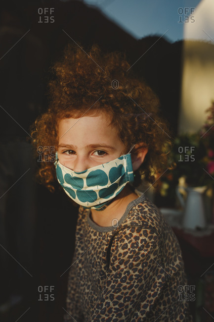 A curly girl wearing hand made protactive mask