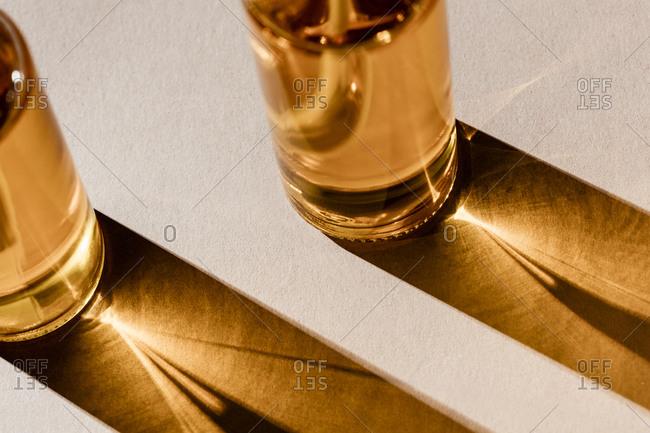 Fragrance oils in glass bottles shining in light