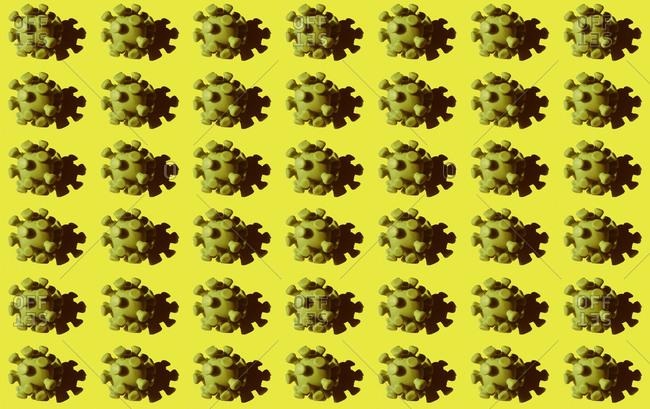 Coronavirus particles against yellow background