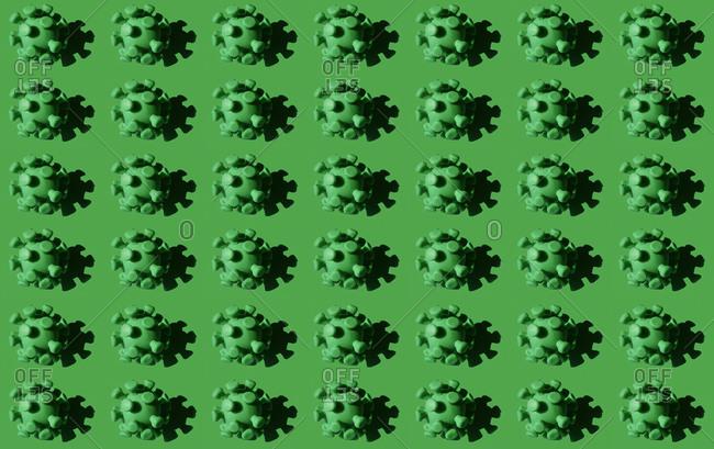 Coronavirus particles against green background