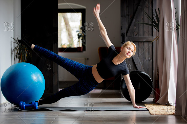 Young woman doing sports exercises at home