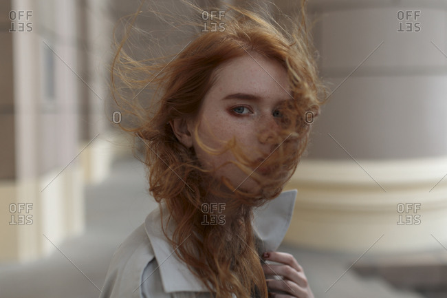 Young woman with windblown hair