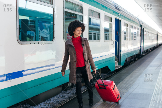 Tourist woman going for vacation trip on train