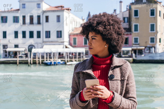 Young tourist woman using smart mobile phone