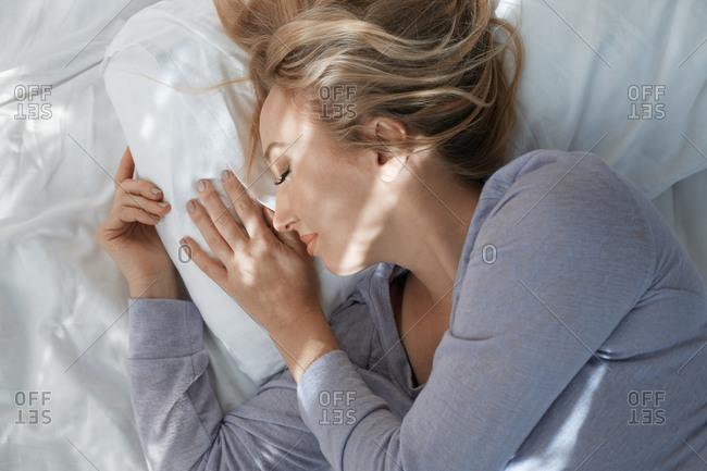 Beautiful blond woman sleeping at the morning