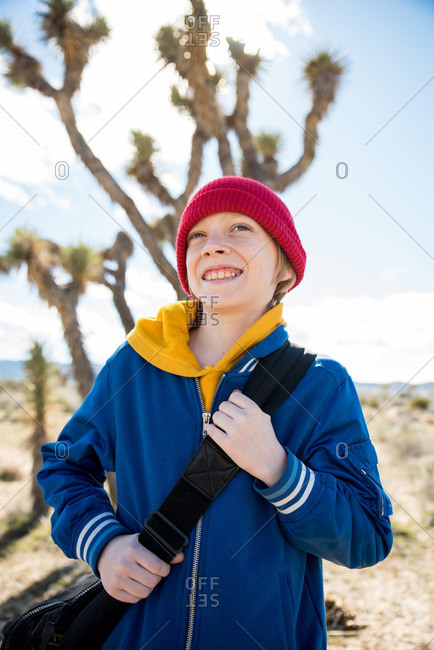 Portrait of tween smiling while out exploring Joshua Tree