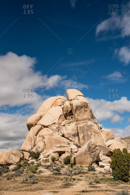 Large stone grouping against blue sky in Joshua Tree National Park