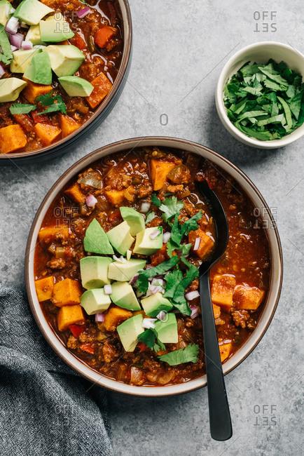 Whole30 paleo chili con carne with sweet potato and fresh avocado
