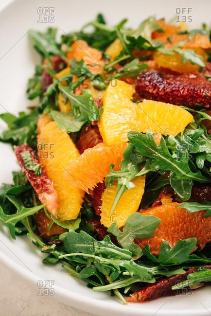 Citrus and arugula salad closeup