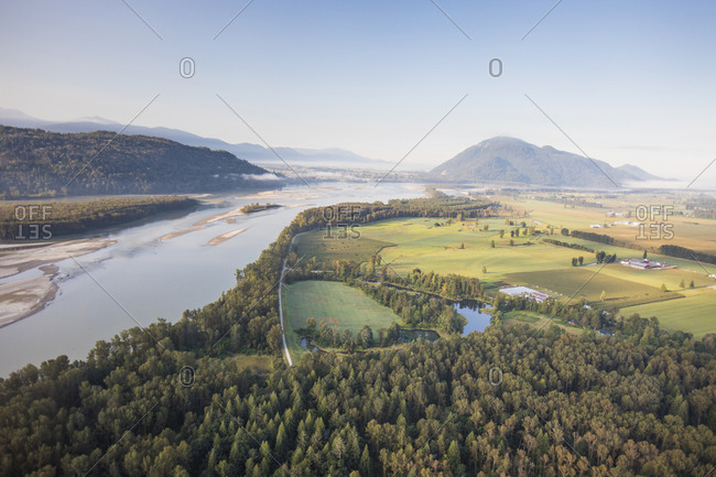High angle view of Fraser River, forest and farms near Mission, B.C.