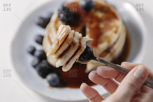 Pancakes with blueberry on a fork