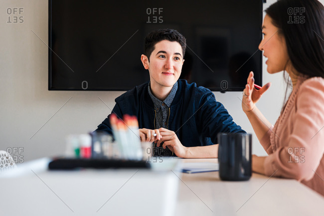Business colleagues planning strategy at table in board room