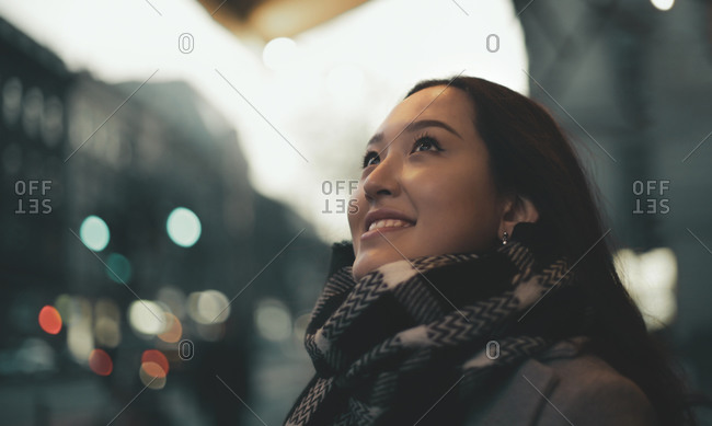 Portrait of a beautiful young woman in a street in wintertime