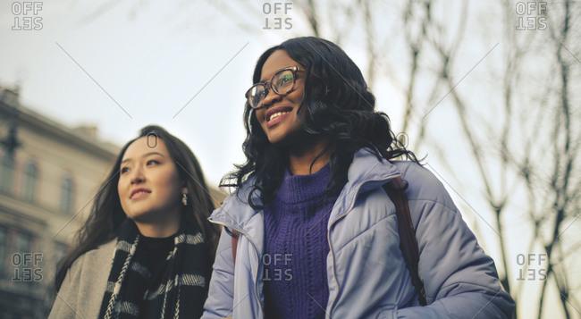 Two girls in the street in winter