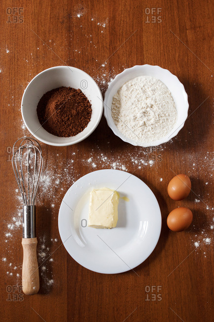 The ingredients needed for preparing homemade chocolate cupcakes