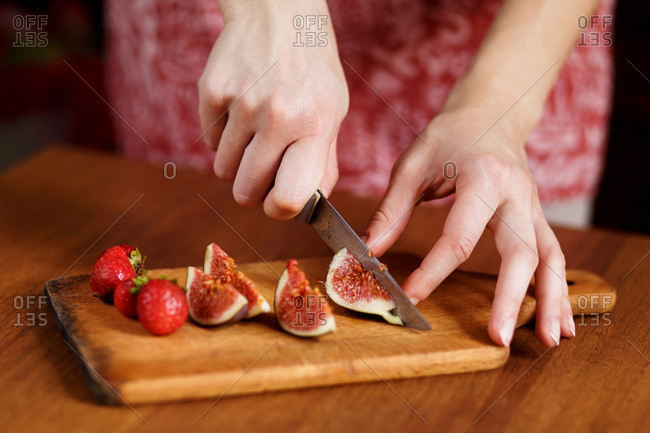 The tasty fruits such as strawberry and fig that are cut on slices