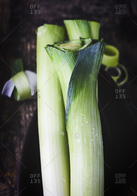 Organic fresh green Leeks vertical wooden background  filtered