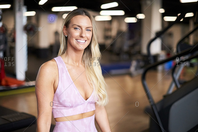 An indoor portrait of an athletic blonde woman.