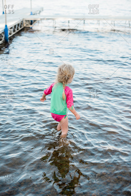 Little girl cooling off at the lake.