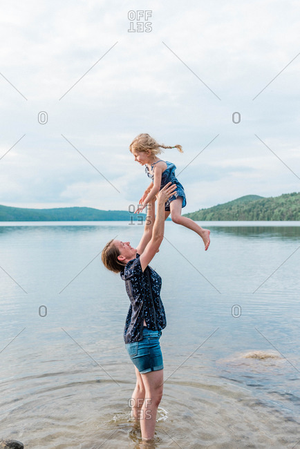 A family during a trip to the lake.
